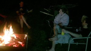 New and old töads socializing over beers and a campfire.